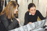 Behnaz Sarafpour, right, with Shkendie Kaziu, selecting fabrics at Jakob Schlaepfer.