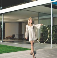 From the Americana Manhasset's spring catalogue, a Michael Kors look in a Fifties setting.