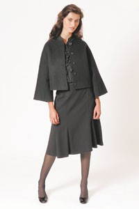Liz Claiborne's double-faced wool jacket, silk ruffled blouse and triacetate skirt.