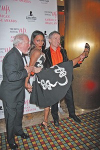 CFDA's Stan Herman (left) with the event's hostess, Robin Givens, and Simon Doonan.