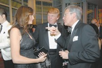 Melania and Donald Trump with Allen Questrom.
