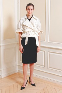 A cropped taffeta trench with leather cutout detail with a lightweight wool skirt.