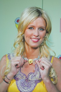 Nicky Hilton wearing a Tweety necklace.
