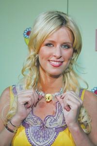 Nicky Hilton wearing a Tweety necklace.