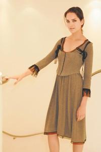 Paola Frani's cashmere dress.