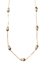 A Disney Couture Jewelry skull necklace.
