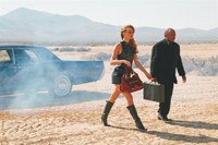 An outtake from Jimmy Choo's fall campaign with Molly Sims and Quincy Jones.