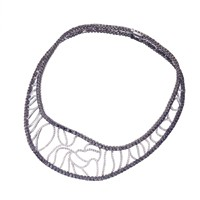 Versace's V Medusa white gold and white and black diamond necklace.