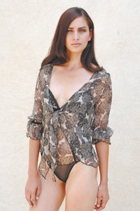 Silk printed blouse over a silk, nylon and spandex bodysuit.