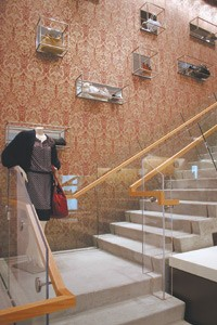 Vintage wallpaper meets a modern floating staircase.