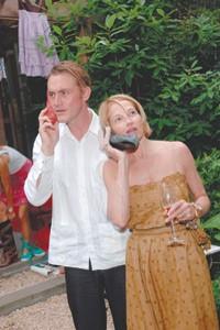"Ellen Barkin in a Geminola dress with Antony Langdon on their ""shoe phones."""