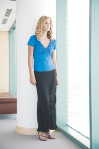 Deed's polyester and spandex knit top and skirt.