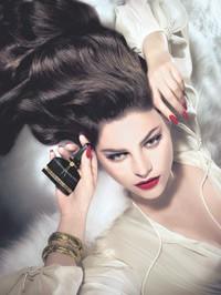 The ad visual features Julia Restoin-Roitfeld.