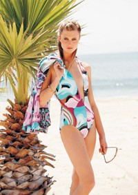 Ann Cole's nylon and spandex swimsuit and silk chiffon cover-up; Coomi bangle; Oliver Peoples sunglasses.