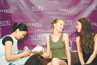 Cygalle (far right) chats with a model at the Brian Reyes show during fashion week.