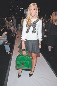 Tinsley Mortimer carrying one of her designs during New York Fashion Week.