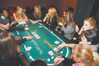 David Rabin teaches his pupils the rules of Texas Hold'em.