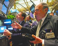 Traders work on the fl oor of the New York Stock Exchange moments after the morning bell Wednesday.