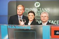 Physicians Formula's Jeff Rogers, Ingrid Jackel and Joe Jaeger ringing the opening bell at Nasdaq.