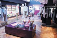 The customer is greeted on the lower level with a large assortment of women's apparel.