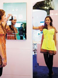 "A model demonstrates the ""magic mirror."""