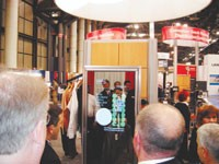 Interactive mirror suggests accessories to shoppers.