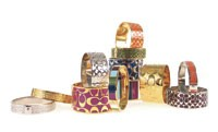 Bangles from Coach's jewelry collection.