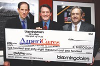 Michael Gould with AmeriCares' Curtis Welling, president and ceo, and Peter Farnsworth, senior vice president and chief financial officer.