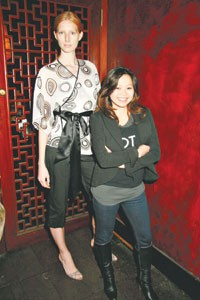 """Chloe Dao with her model from """"Project Runway"""" wearing a design from Dao's new QVC line."""