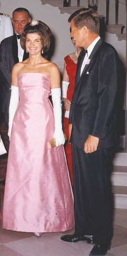 Jacqueline Kennedy in Guy Douvier for Christian Dior with John F. Kennedy Jr. at a White House dinner in 1962.