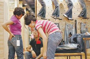 A customer tries on a pair of Cons jeans, a Turkish label, at the brand's store in Istanbul.