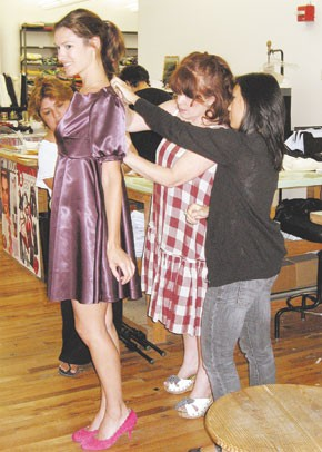 Nitibhon works on a fitting with Necessary Objects designer Ady Gluck-Frankel.