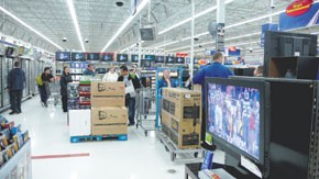 Wal-Mart is depending on earlier promotions to boost holiday revenue.