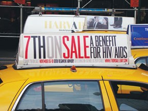 A taxi carrying 7th on Sale's new ad.