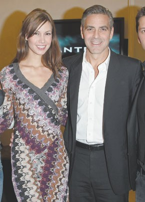 George Clooney and his girlfriend, Sarah Larson, at Belstaff.