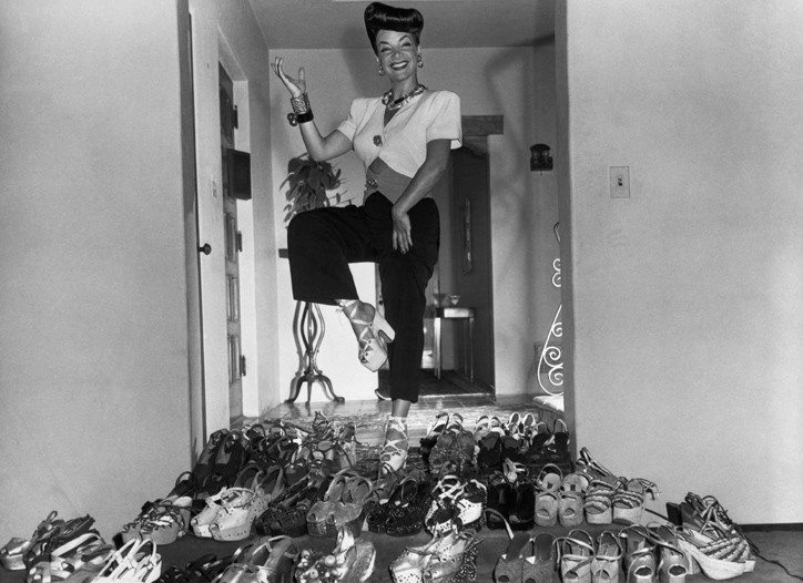 The 5-foot-2-inch Carmen Miranda gets a lift from her extensive shoe collection in 1944.