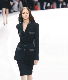 A stylish wool suit with unusual pocket detailing from Karl Lagerfeld's collecton for Chanel.
