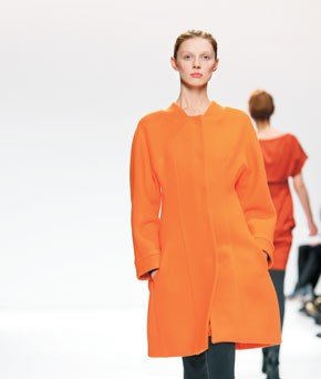 Narciso Rodriguez's lineup of mostly black-and-white fare got an occasional jolt of orange, as in this chicly structured double-faced wool coat.