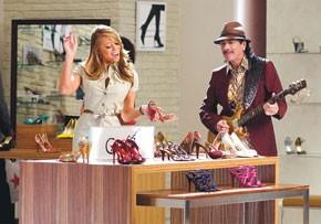 Carlos Santana and Mariah Carey in a Macy's commercial.