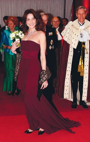 Carla Bruni-Sarkozy, in a Dior gown, arrives at Guildhall for a white-tie dinner with the Lord Mayor of London.