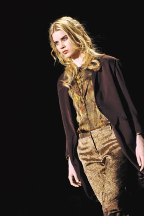 One of Olivier Theyskens' arty, slim looks: a tailored jacket worn over a blouse and skinny pants.