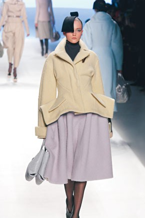 Louis Vuitton by Marc Jacob's jacket with pleated details at the hips and a full skirt, both in the thick, cozy fabrics he favored throughout.