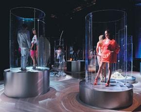 Here and bottom left: Live models stood in Plexiglas columnar displays in Calvin Klein's lifestyle installation in Dubai.