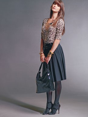 A printed cardigan, pleated skirt and patent leather hobo bag from Victor by Victor Alfaro.