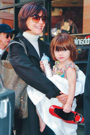 Katie Holmes with daughter Suri and her coveted Roger Vivier shoes.
