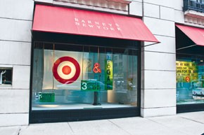 Barneys New York windows feature the Target logo and promote the lower-priced Rogan line.