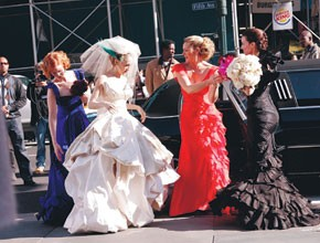 Sarah Jessica Parker in a Vivienne Westwood wedding gown with her bridesmaids, Cynthia Nixon, Kim Cattrall and Kristin Davis