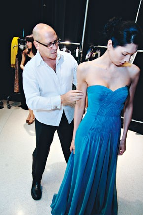 Carmen Marc Valvo fits a model in Natick, Mass.