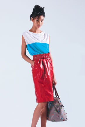 Bottega Veneta - Here, a color-blocked jersey top and leather skirt.