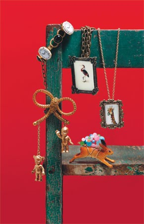 Clockwise from top left: A clockwork brass bracelet with jet cabochons from Erickson Beamon for Anna Sui at Showroom Seven; Pamela Touhy's brass heron pendant and gold vermeil-on-silver giraffe pendant, both with resin-coated parchment images; Space...